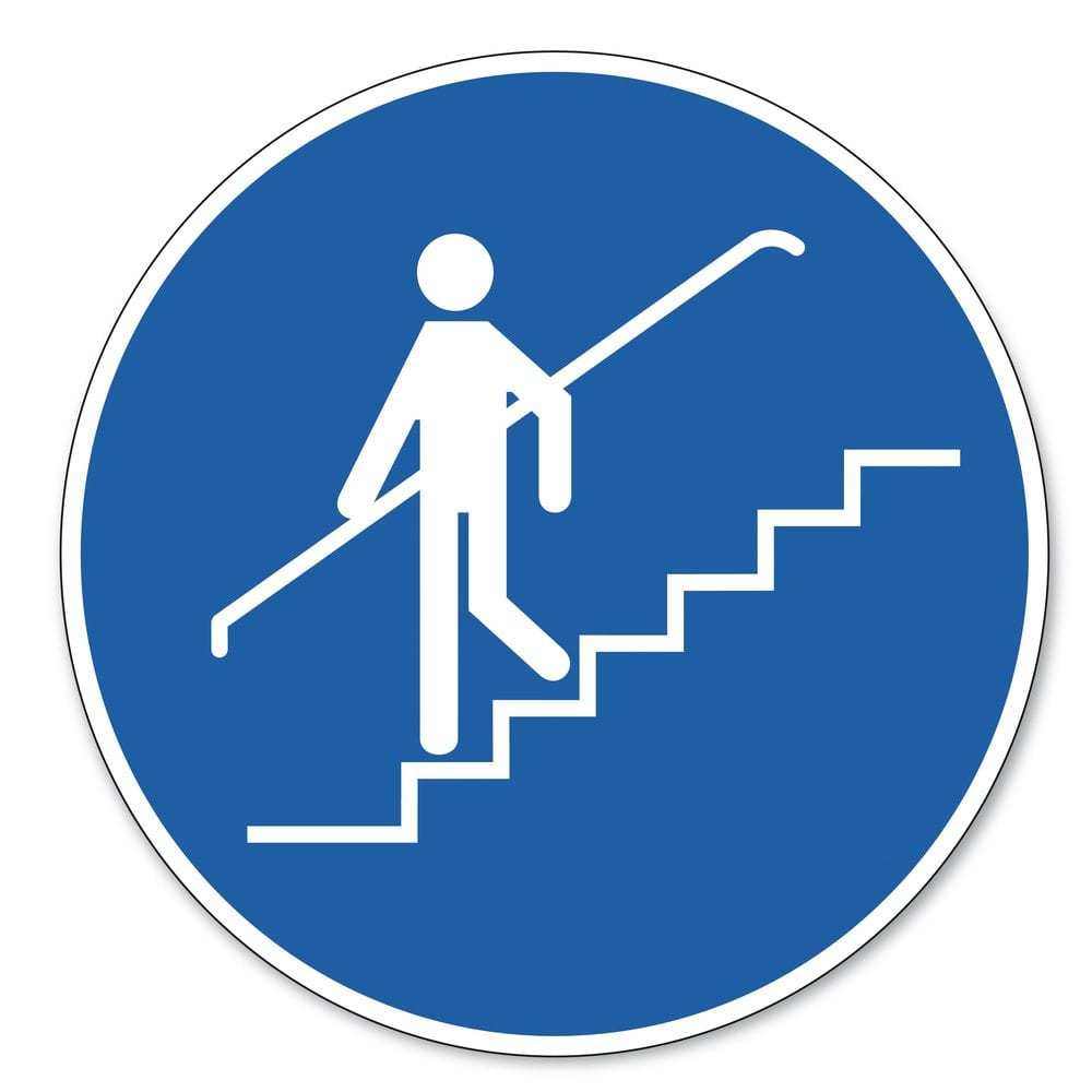 safety sign showing person walking down stairs holding handrail