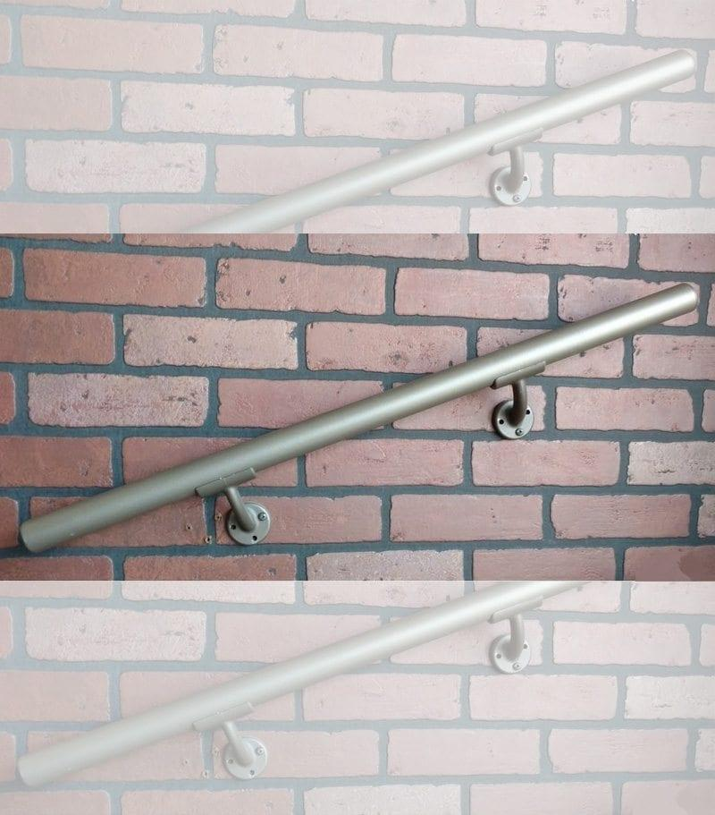handrail section with mounts on a brick wall