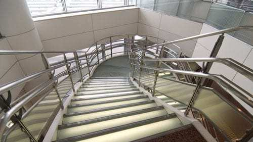 looking down stairs with handrails and guardrails