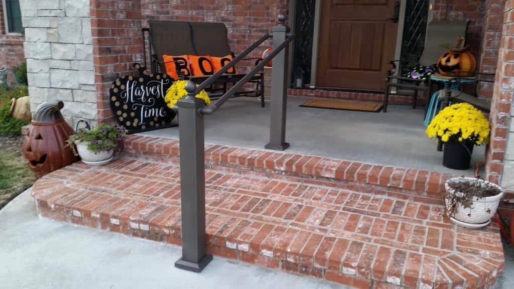 handrail (from Aluminum Handrail Direct) on steps leading up to front door